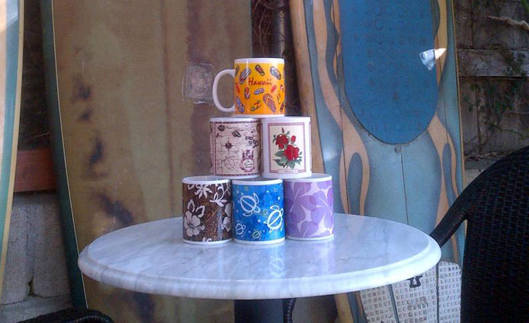coffee mugs and old surfboards