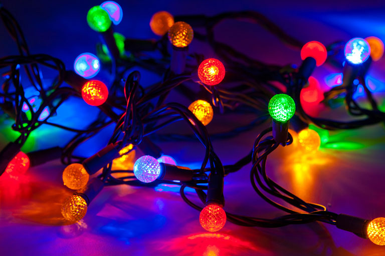 Businesses light up the neighborhood for the holiday season