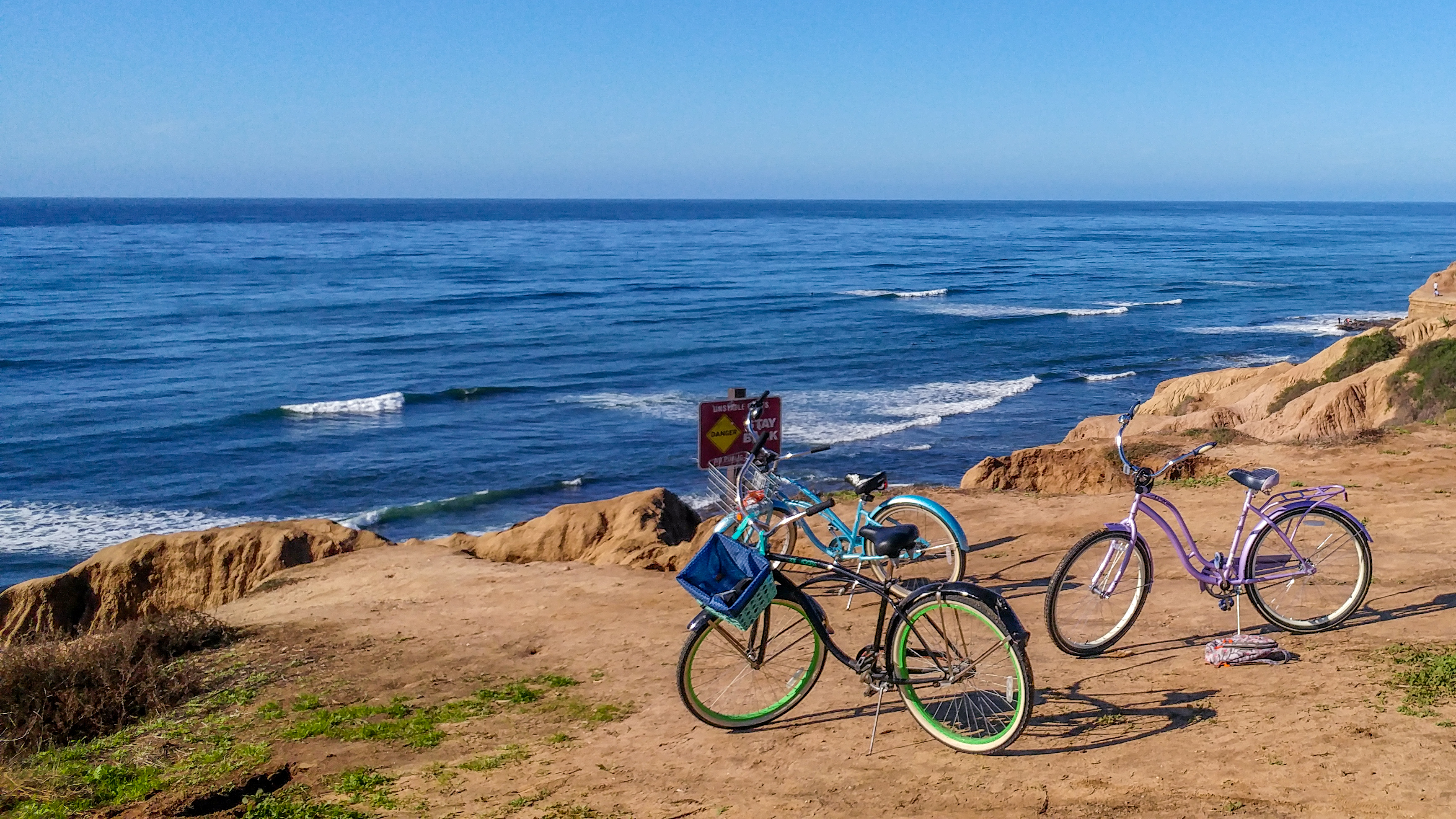 Two beach cruisers near sunset cliffs