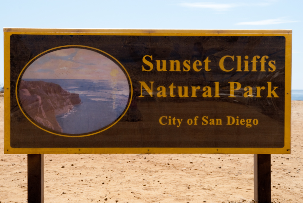 Sign that reads Sunset Cliffs Natural Park City of San Diego