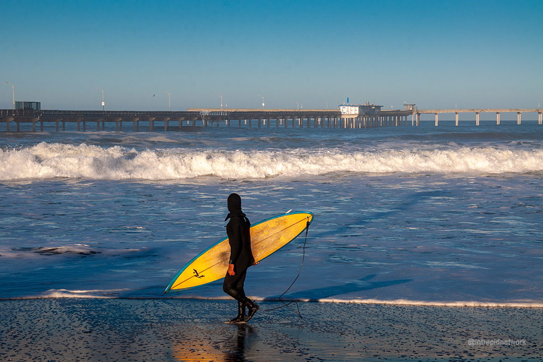 Surfer looking at OB Pier