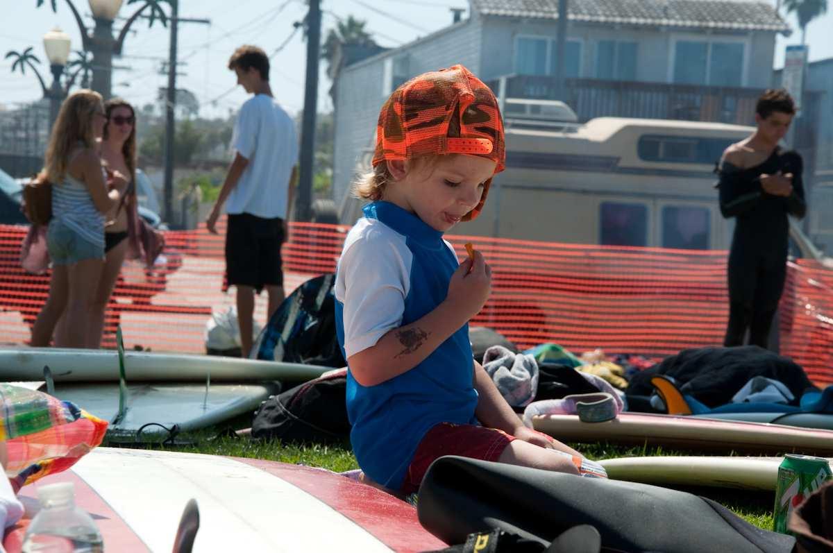 Surfer at Ocean Beach Grom Fest in San Diego California