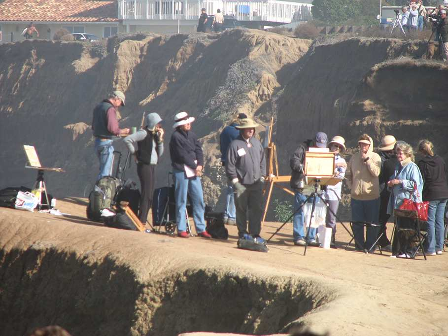 artists painting at the cliffs