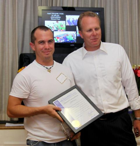 Josh Utley receives award from Kevin Faulconer